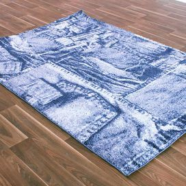 Equally at home in your contemporary living room or child's bedroom, this eye-catching rug features a denim-inspired design in blue tones. Showcase alongside painted white furniture, bare wood floors and matching accents to create a focal point.  Product: RugConstruction Material: PolypropyleneColour: BlueFeatures: Heat setPile Height: 1 cmDimensions: 133 cm x 190 cmNote: Please be aware that actual colours may vary from those shown on your screen. Accent rugs may also not show the entire…
