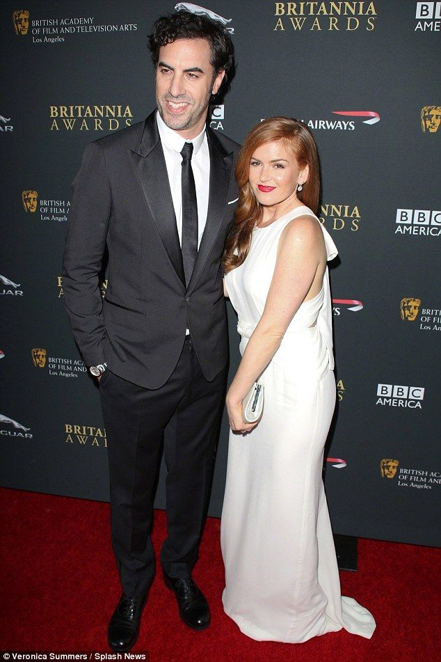 Another one on the way?: Isla Fisher and Sacha Baron Cohen, pictured in November, are expecting their third child, according to a Wednesday report from UsWeekly