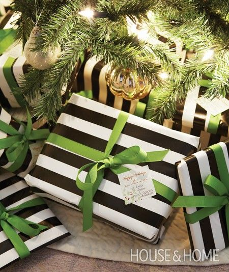 Bold Holiday Colour Combinations- Black and white wrapping paper with green ribbon.
