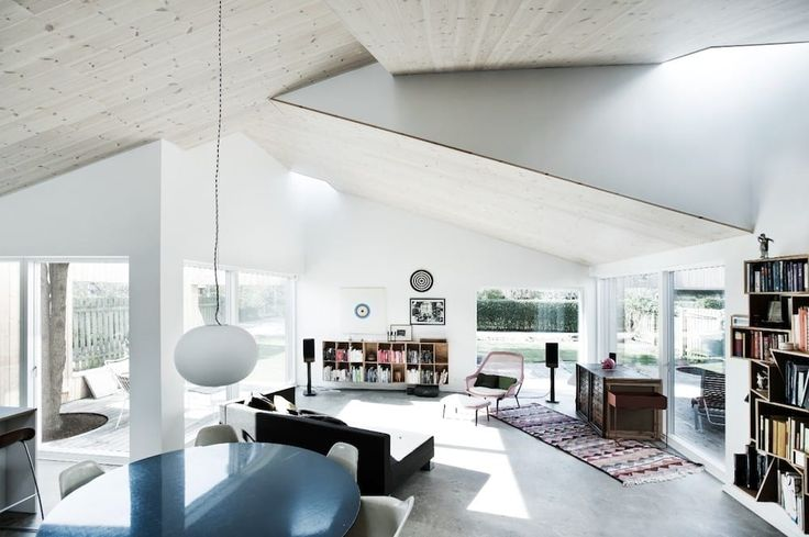 This home has church-like ceilings. The skylights result in plenty of natural light.