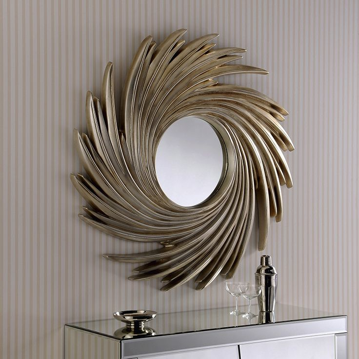 Please note this is a made to order item and can take 4 - 6 week for production     This round champagne silver swirl mirror is just oozing with luxury. It looks as expensive as it sounds and will instantly enhance any desired living space. The infinite swirl of this gorgeous mirror