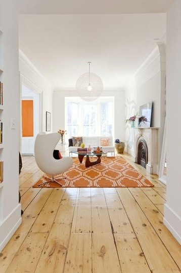 I love the bright light minimalist interior pops of orange mid century furnishings and wide plank floors interiors by esmeralda love the wide pine