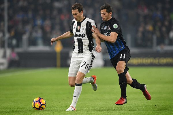 Stephan Lichtsteiner (L) of Juventus FC is challenged by Remo Freuler of Atalanta BC during the Serie A match between Juventus FC and Atalanta BC at Juventus Stadium on December 3, 2016 in Turin, Italy.