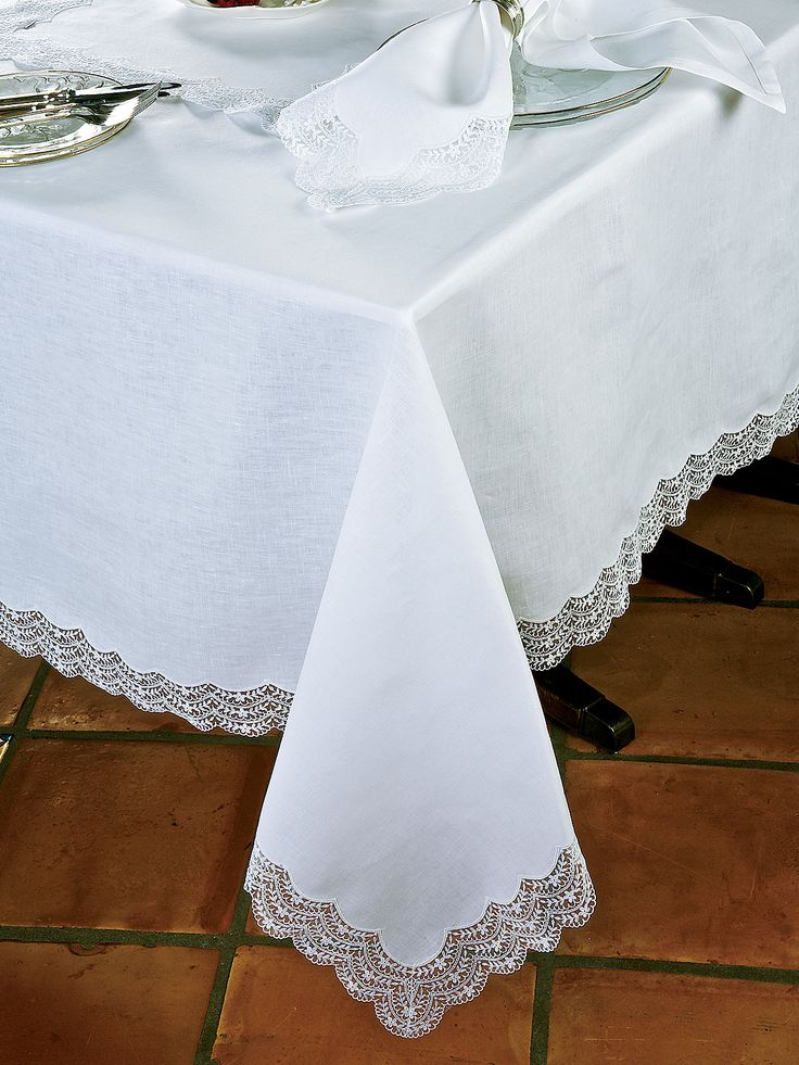 Conveying an air of festivity that will cheer your guests, tiers of scalloped tulle lace embroidered with mini scallops and flowers are like icing on cake. Delicious embellishment for tablecloths and napkins of freshest 100% linen. Tastefully designed in Italy, to have in White on White. Luxury Table Cloths