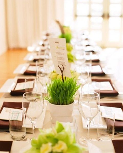 Square Service  with Maroon Napkins wrapped and menu placed on top., with a runner of green.