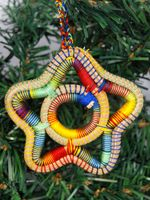 Cute multicolor star ornament, handmade by artisans in Nicaragua! Learn more: http://vimeo.com/20223520 - www.fabretto.org