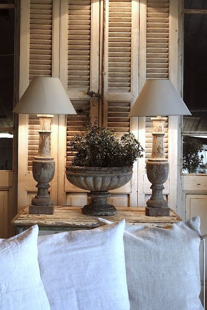 Love the shutters, the table, and those lamps!