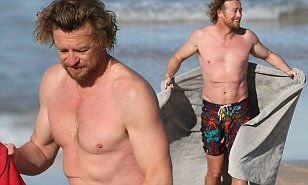 Australian actor, Simon Baker looked happy and healthy while braving icy winter temperatures in Sydney on Thursday