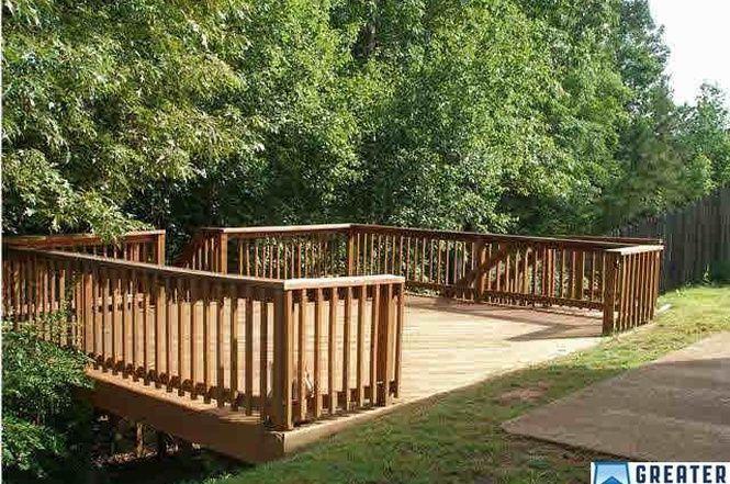 Sloped Back Yard Solution Sloped Backyard Backyard Deck Designs Backyard