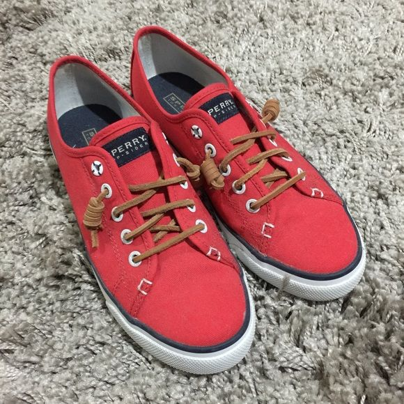 Red Sperry Sneakers Cute casual red low cut sneaker. Brown laces make the shoe so cute. Worn only twice. Shoe is 8 1/2 but I'm normally a 8 and they fit perfect Sperry Shoes Sneakers