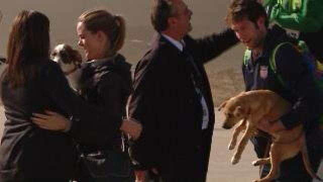 Olympic Basketball player Backes returns from Sochi with 2 stray dogs,