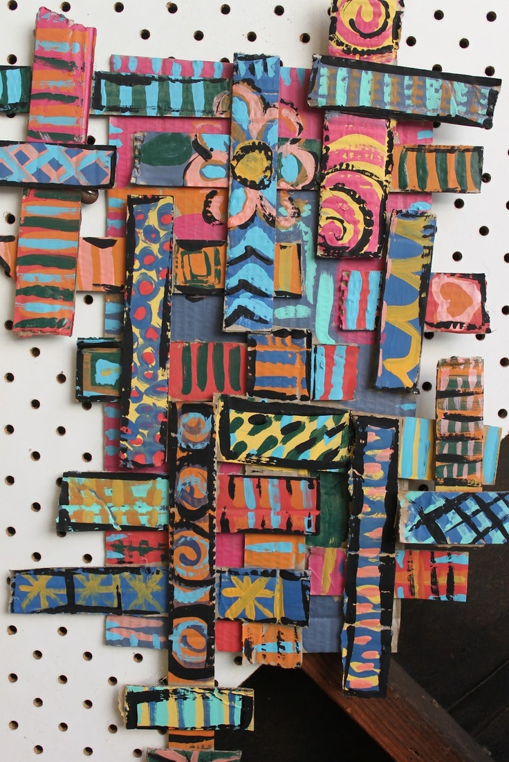 cardboard sculptures, by layering cardboard strips of different lengths, and then adding acrylic paint designs to the top.