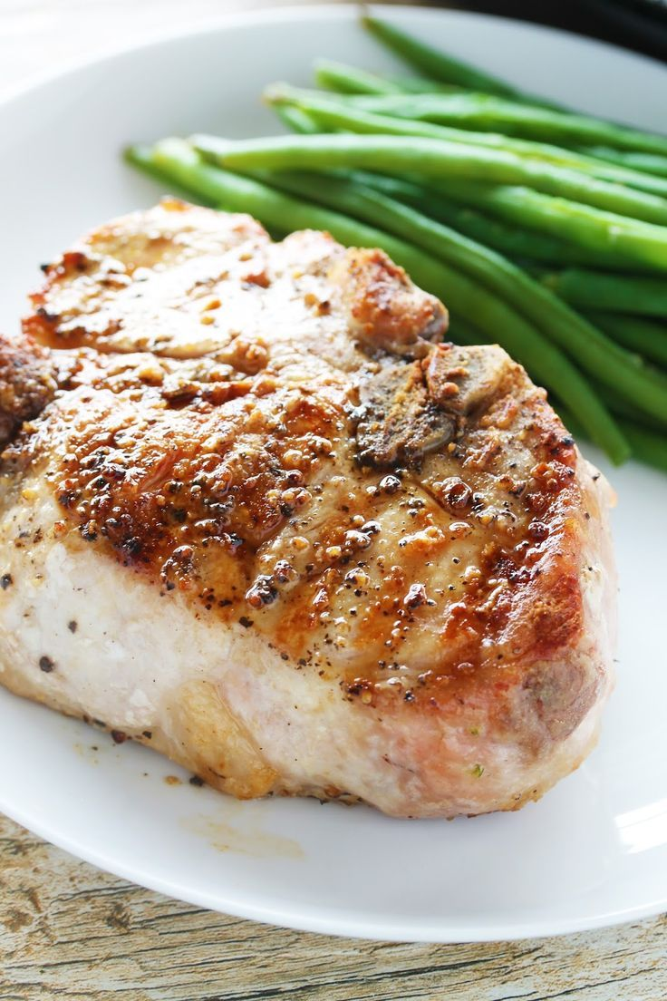 How to Cook the Perfect Thick Cut Pork Chops. Includes a video tutorial to walk you through the step-by-step process of cooking the juiciest, most flavorful pork chop of your life!