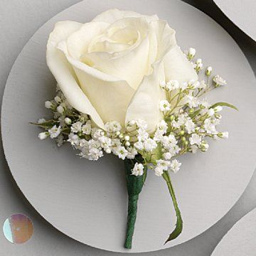 White Rose Boutonniere; Amazing photos of weddings - including bride flowers, corsage & bouts, unique centerpiece ideas, church & reception.  Easy to follow directions for floral arranging.