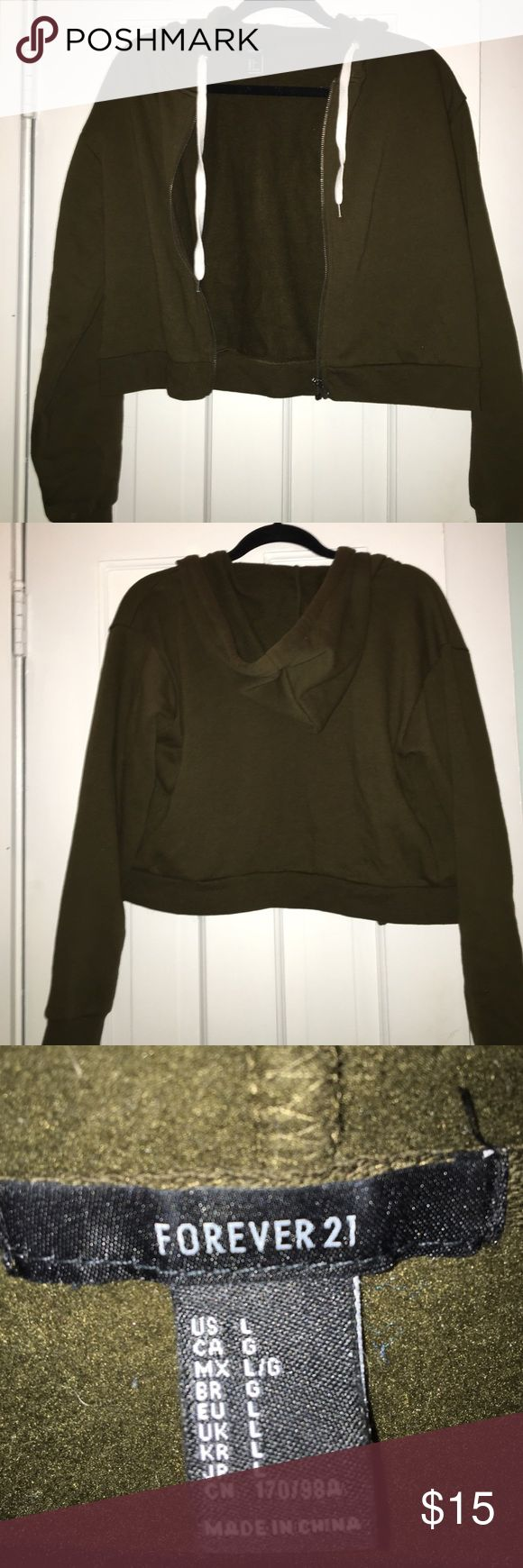 Forever 21 NEW green zip up hoodie This is a cropped dark olive green zip up hoodie. It's very soft and has never been worn. NEW! Forever 21 Sweaters