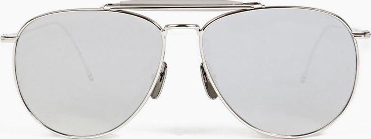 Thom Browne Silver TB-015 Limited Edition Aviator Sunglasses The Thom Browne TB-015 Limited Edition Aviator Sunglasses, seen here in silver. - - - A stand-out style from the New York-based designer, these classic aviator sunglasses from Thom Browne are hand-mad http://www.comparestoreprices.co.uk/january-2017-6/thom-browne-silver-tb-015-limited-edition-aviator-sunglasses.asp