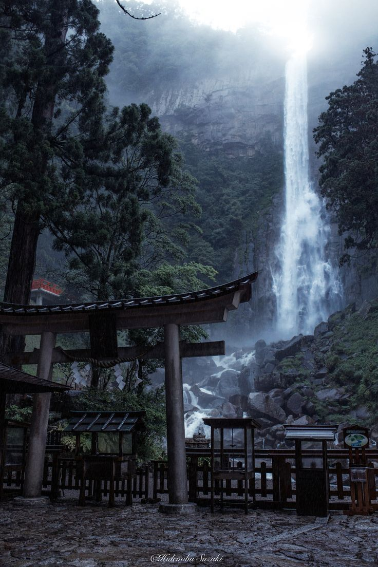 "Rain waterfall - ""Nachi Great Waterfall"" UNESCO World Heritage sites. The Nachi Water Fall is 133 meters high, 13 meters wide, and has a water flow of one ton per second. This is actually the highest waterfall in Japan and the object of the worship in the Kumano Nachi Grand Shrine."