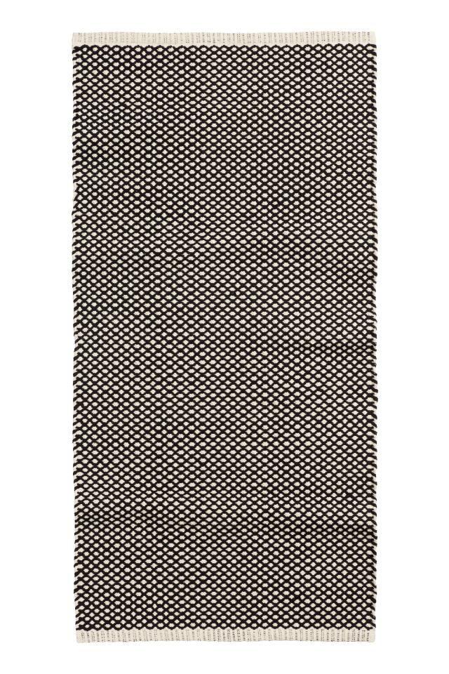 Tapis en coton tissé jacquard: Tapis rectangulaire en coton tissé à motif jacquard.