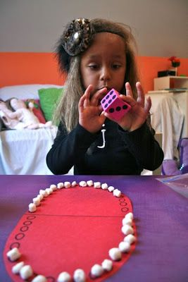"""Just roll a die and put that many marshmallow """"teeth"""" on the board.  First one to fill their side wins. Journey To Josie: Pearly Whites"""