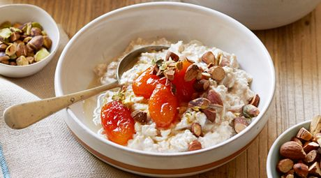 Enjoy Bircher Muesli with Apple, Apricots and Almonds for brunch this weekend! It's served with deliciously plump apricots cooked in a sweet honey syrup with crunchy almonds and pistachios on top.