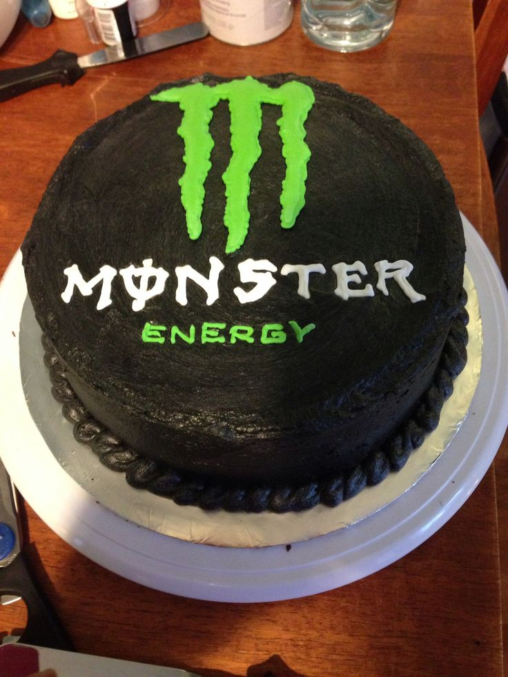 Monster Energy Cake I made for my husband's friends 40th! Used royal icing to make the transfers, black buttercream outside, dark chocolate fudge cake with lime green buttercream Oreo filling!