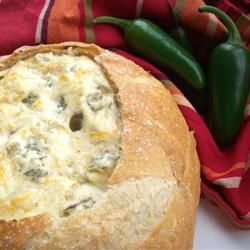 Insanely Amazing Jalapeno Cheese Dip (serve hot)  1 (4 ounce) can diced jalapeno peppers   1 cup shredded Parmesan cheese   1/2 cup shredded Cheddar cheese   1 cup mayonnaise   1 (4 ounce) can chopped green chilies   1 round loaf sourdough bread