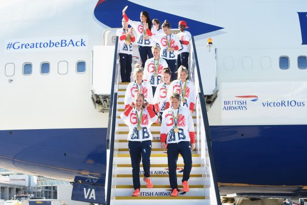 Team GB athletes and members of the women`s gold medal winning hockey team leave the airplane after arriving home at Heathrow Airport (Getty Images)