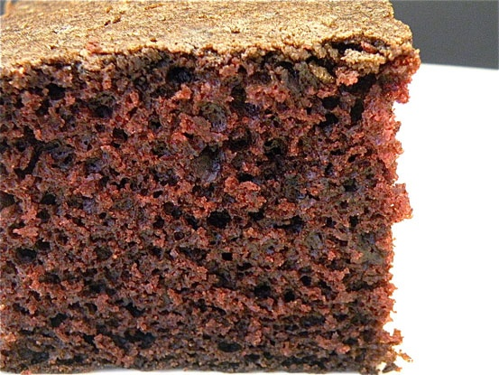 "Old Fashioned Chocolate Cake, made without eggs, milk or butter. Get's it's ""poof"" from the reaction between vinegar and baking soda. Popular during the war when many food items were rationed. It's a dense and delicious chocolate cake."