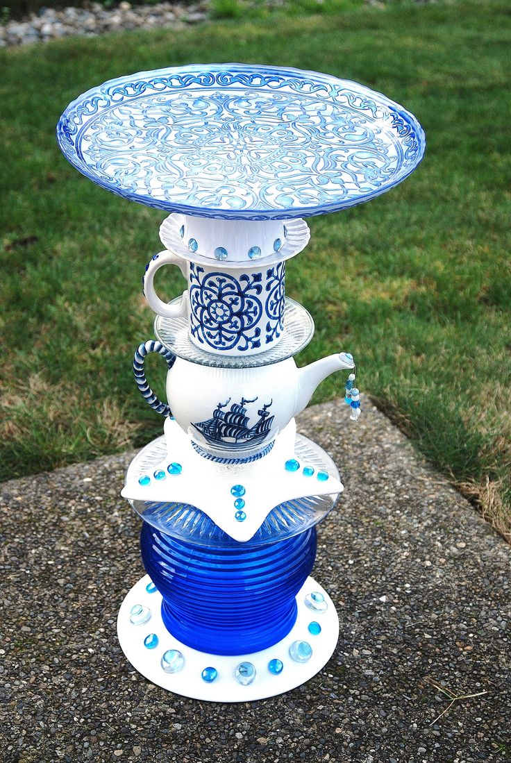 MINE- Love this one.  It sits in my front flower bed. Large Blue base purchased from Burlington Coat factory, all other items (teapot, coffee cup, topper) purchased from Marshalls, white base above coffee cup from Ikea.