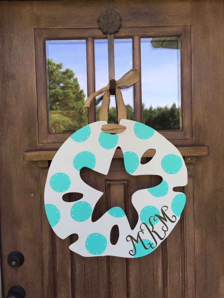 A personal favorite from my Etsy shop https://www.etsy.com/listing/245821283/20-shabby-chic-sand-dollar-door-hanger