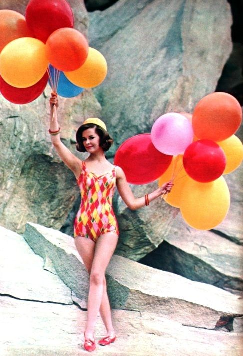 Bathing suit. And ballons. Full of colors.