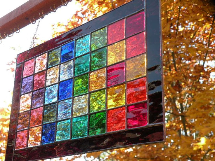 """Rainbow  stained glass window panel.  Reminds me of the """"pane of colored glass"""" in the chocolate colored house from the Betsy-Tacy books by Maude Hart-Lovelace."""
