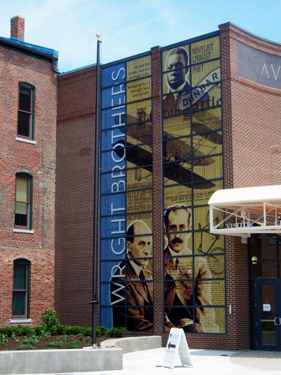3-story tall perforated window film graphics for Wright Brothers museum