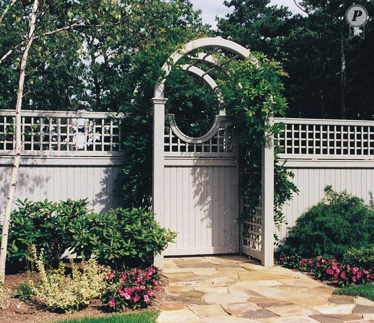 Arched arbor with moon gate and english trellis fence for Fence with arbor