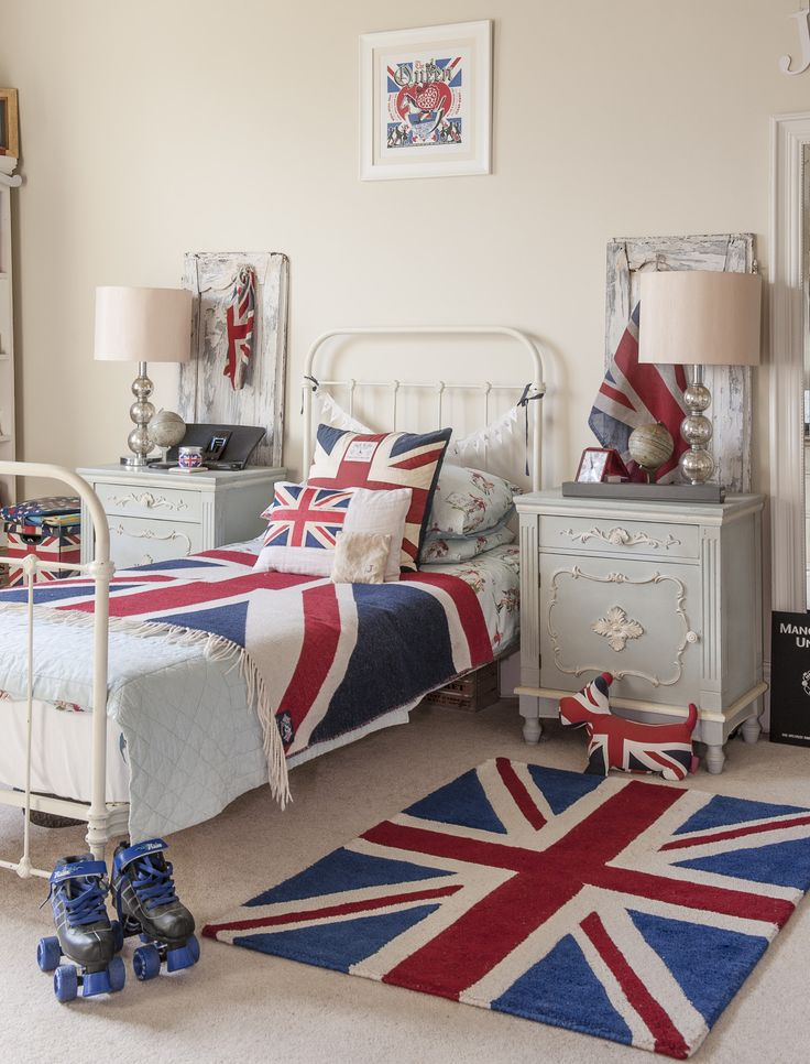 Son James's immaculate room features a French distressed dressing table, French antique bedside tables and a Union Jack bedspread and rug