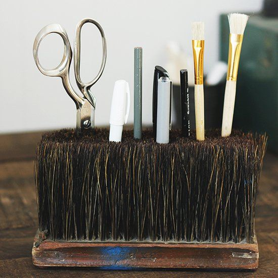 Use an old broom head to help get your desk organized! looks so good the older the broom the better