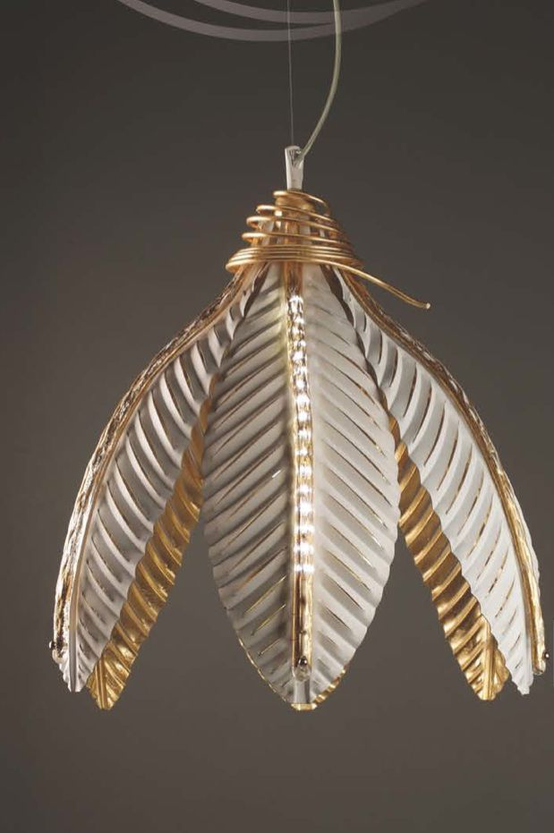 Pendant light with the natural look of leaves and the style of gilt touches - and gilt inside.