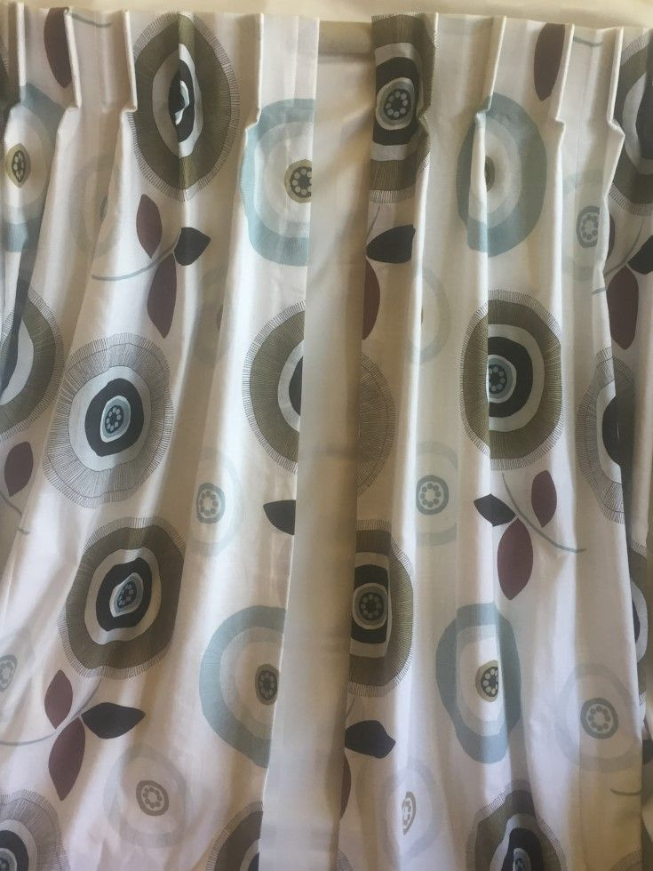 Circles. Two glorious Linen mix curtains and a matching roman blind. Love the duck egg blue. Curtains measure 184 cms wide each top x 220 cms long, cost $750.00 the pair, and the blind 141 cms wide x 148 cms long, $300.00.