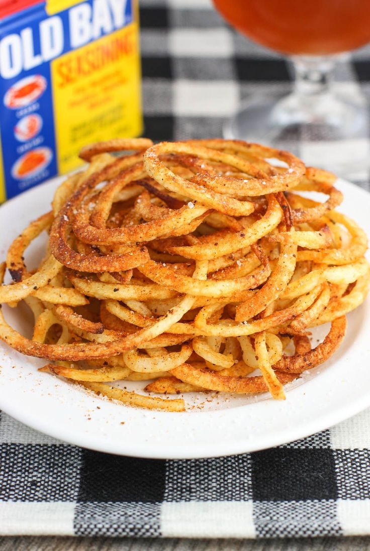 These Baked Old Bay Curly Fries use a spiralizer for a quick side dish or snack recipe. The fries are baked but crispy, and seasoned with slightly spicy Old Bay flavor. These won't last long!