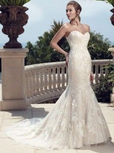 Non-beaded embroidered appliqués on Soft Tulle over Devoré Silk Chiffon create this gown. Godets in the Soft Tulle overlay add movement to t...