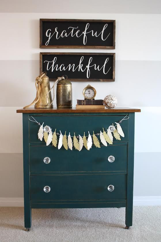 Royal Teal dresser.  The feathers just fit there.  Will have to use this idea.  www.countrychicpaint.com/blog
