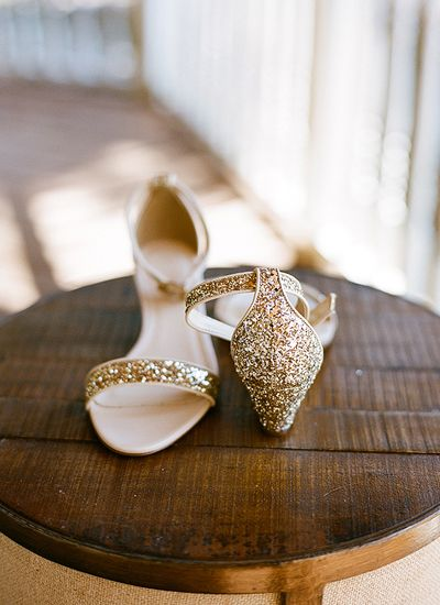 Low heels in glittery gold pair well with a good dance floor.