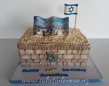 This cake was a huge lemon cake made for the 50th anniversary of Jerusalem. It has 50 years since jersusalems city has been given back to its people. Star of David and the coat of arms made out of pastiage and scripture is a edible image done by kiwicakes. This is the whaling wall of Jerusalem, people pop their prayers on a piece of paper and place them in the wall.  #jerusalem   #walingwall   #starofdavid   #coatofarms   #christ   #pettinice   #cakesnorthland   #caketinlove…