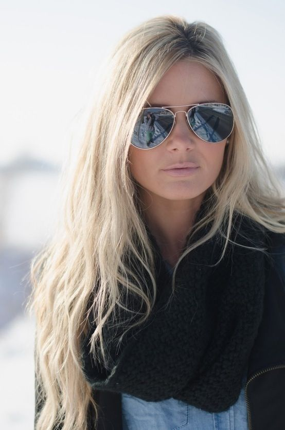 A winter wonderland with Aloxxi Hair Color Personality Andiamo - Let's Go Platinum™.  blonde | middle part | long hair | nude lips | aviators | beautiful hair | tan skin | gorgeous