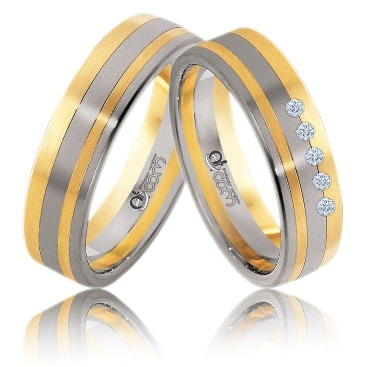 Verighete ATCOM ATC177 aur alb cu galben cu 5 pietre tintuite pe banda de nunta a damei.