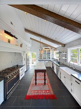 EEEEak! Planked ceiling, black tile floor, tiled glossy backsplash walls, glass cabinets, antique island....and BEAMS???? Oh don't forget farmhouse sink. Kitchen will you marry me?
