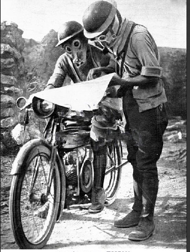 An English motorcyclist stops to check the map on the Salonika Front, Greece, 1916.