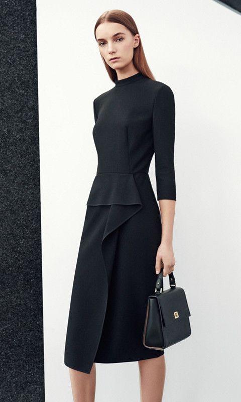 Zwarte jurk en zwarte tasvanBOSS