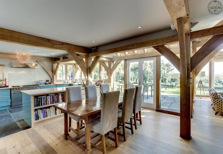 Open plan kitchen and dining areas, Plastered ceilings and oak framing. By Roderick James Architects