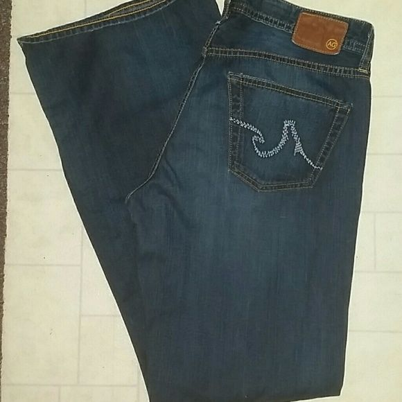 """AG Adriano Goldschmied """"the Filmore"""" jeans 32 Wonderful pair of Adriano Goldschmied the Filmore jeans. 5 pocket. Wide leg. Sz 32 x 32 very good condition. 100% cotton Rise= 9.5 inches Inseam = 32 inches Leg cuff=10.5 inches AG Adriano Goldschmied Jeans"""